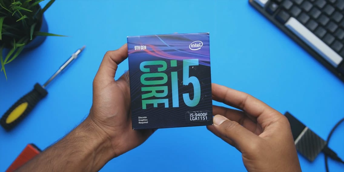 Holding Intel Core i5 9400F CPU box